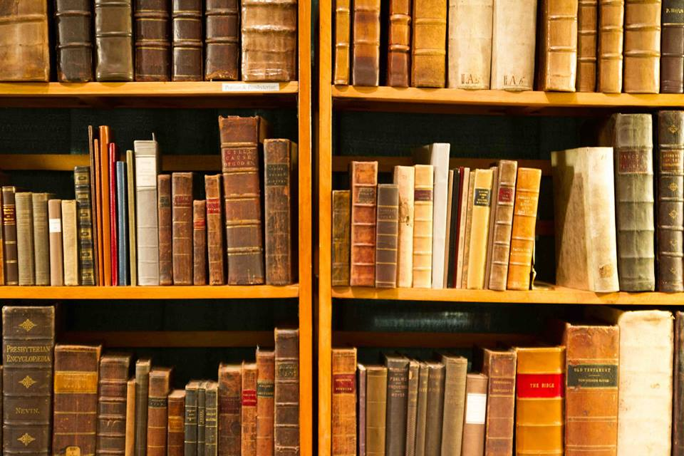 Antique books on a shelf