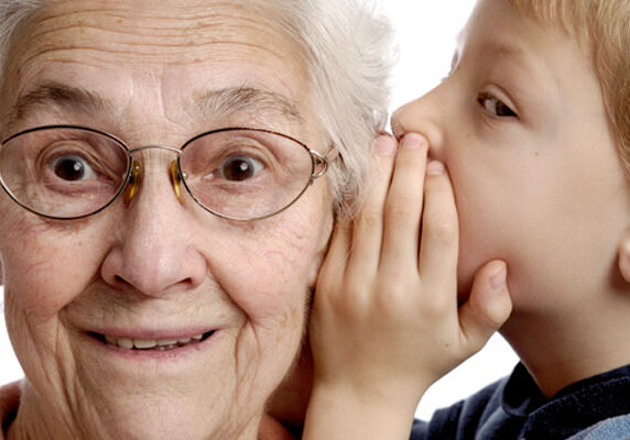 Child Whispering in Grandmother's Ear