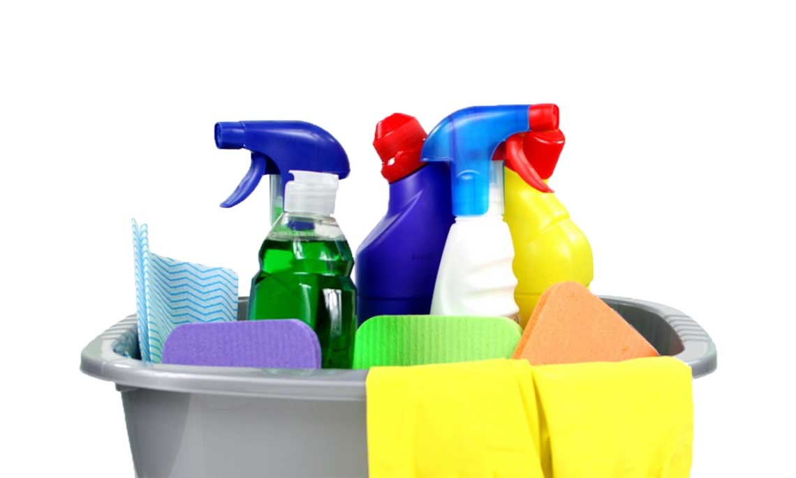 bucket with cleaning tools like cleaning spray bottles and sponges