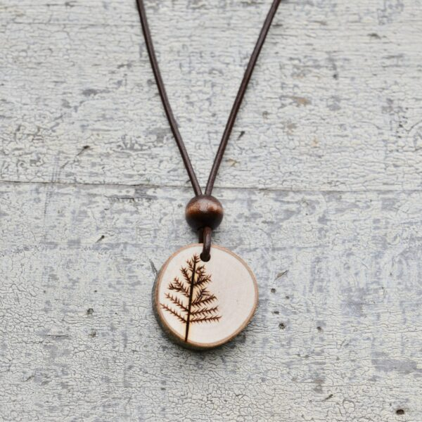 wood burned tree necklace with dark wood bead