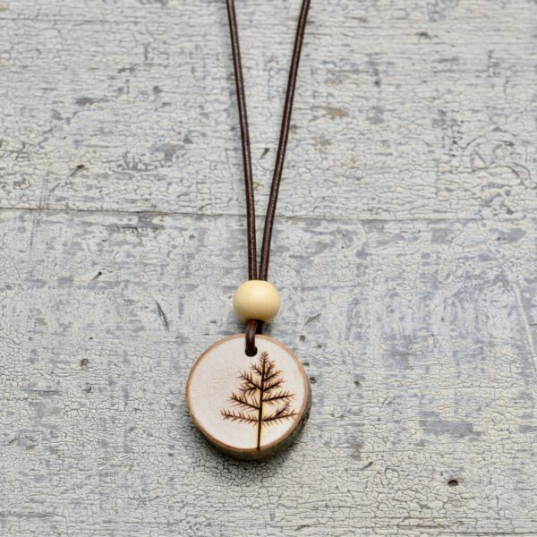 wood burned tree necklace with light wood bead