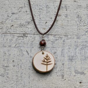 wood burned tree necklace with red stone bead