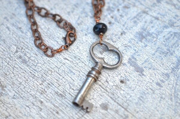 antique key necklace with copper chain and brown gemstones clasp