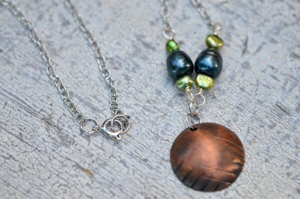 copper dome necklace with blue and green clasp