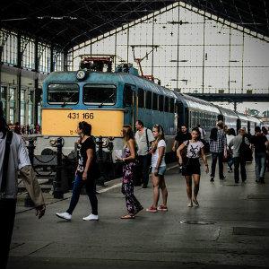 passengers preparing to board a train