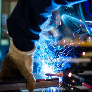 welder working with metal