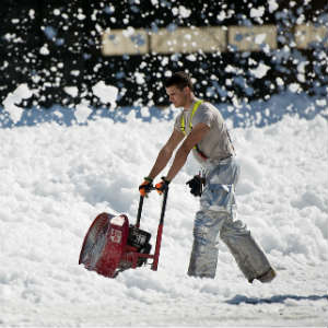 worker removing snow