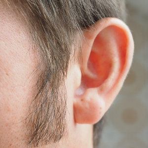 worker suffering from hearing loss