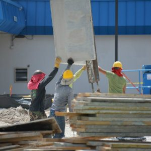 workers helping one another