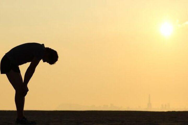 Man bending over tired.