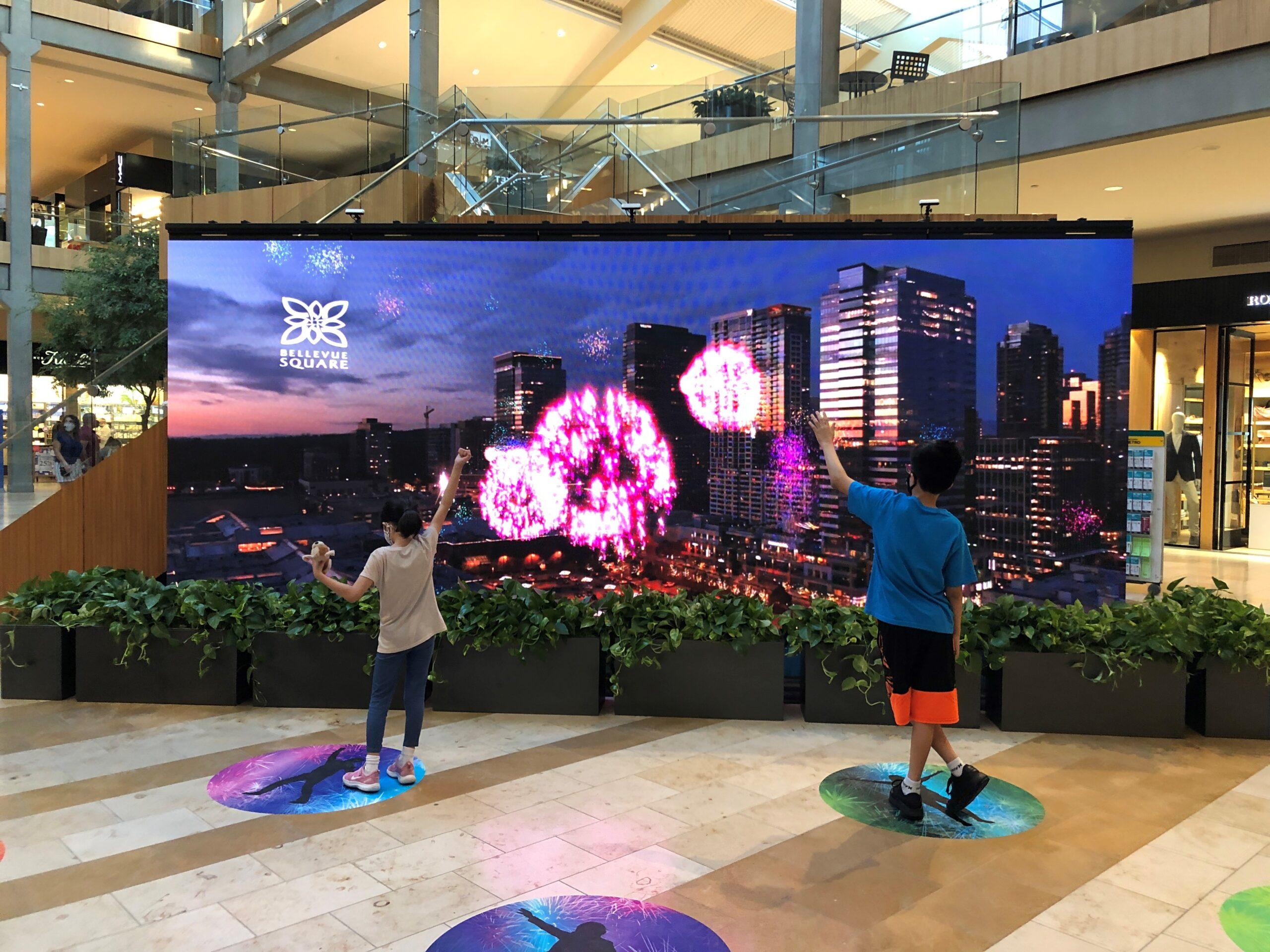Kids at Interactive wall photo
