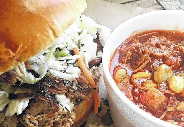 Smoked pulled pork sandwiches with slaw and baked beans