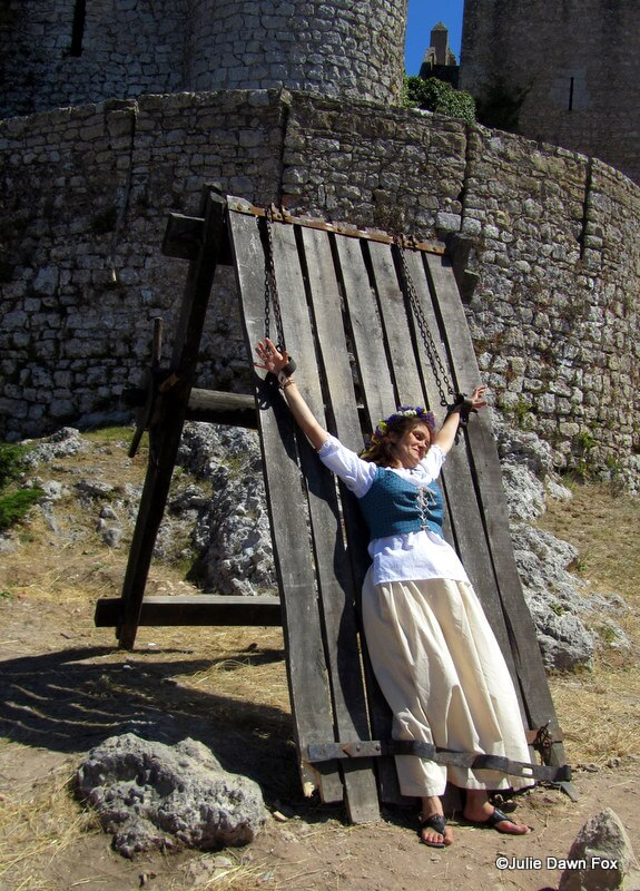Woman in costume posing on the rack at the medieval fair in Óbidos