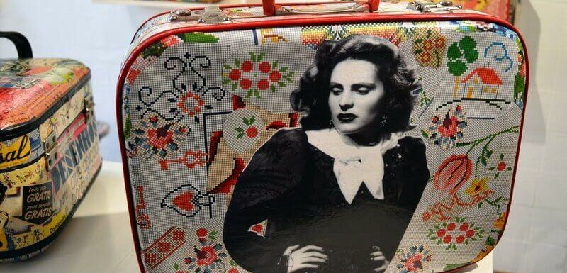 Suitcase with Amália on front. Packing Tips for Portugal
