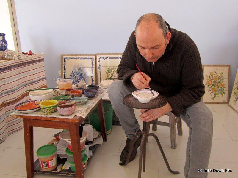 Sr. Melho painting pottery by hand at Conimbriga
