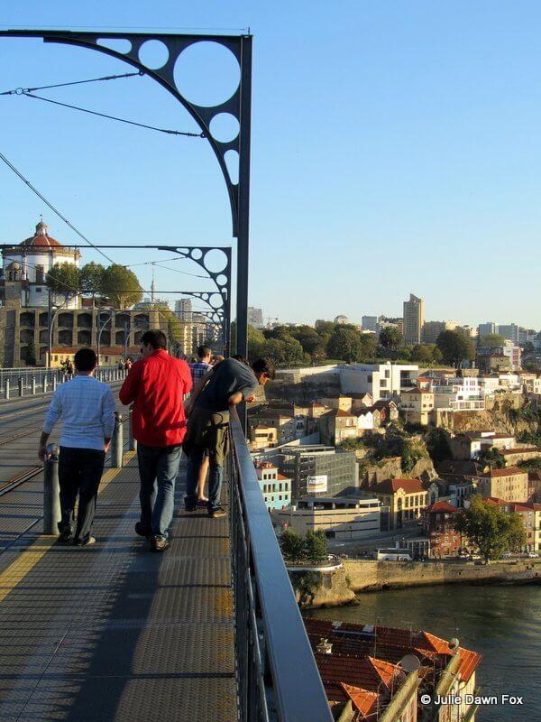 Walking over Dom Luís bridge, Porto.