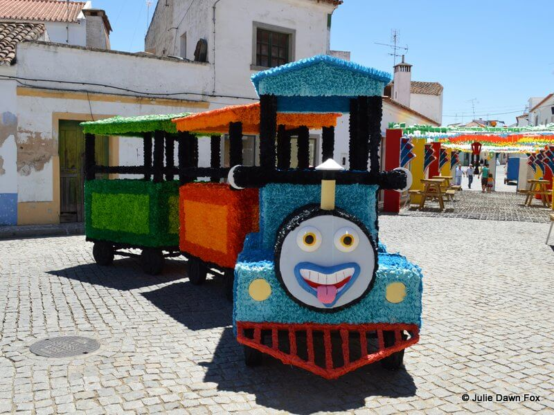 Colourful steam train with a happy face, all made from paper