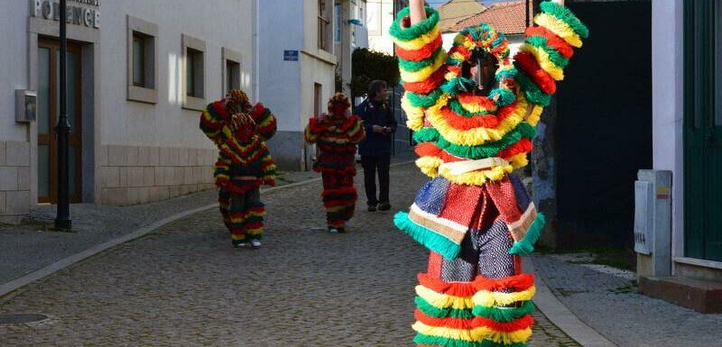 Caretos in the streets of Podence. Photography by Julie Dawn Fox in Portugal