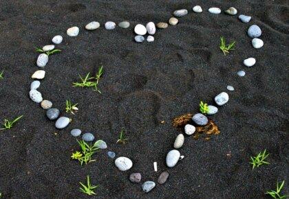 Heart in black sand