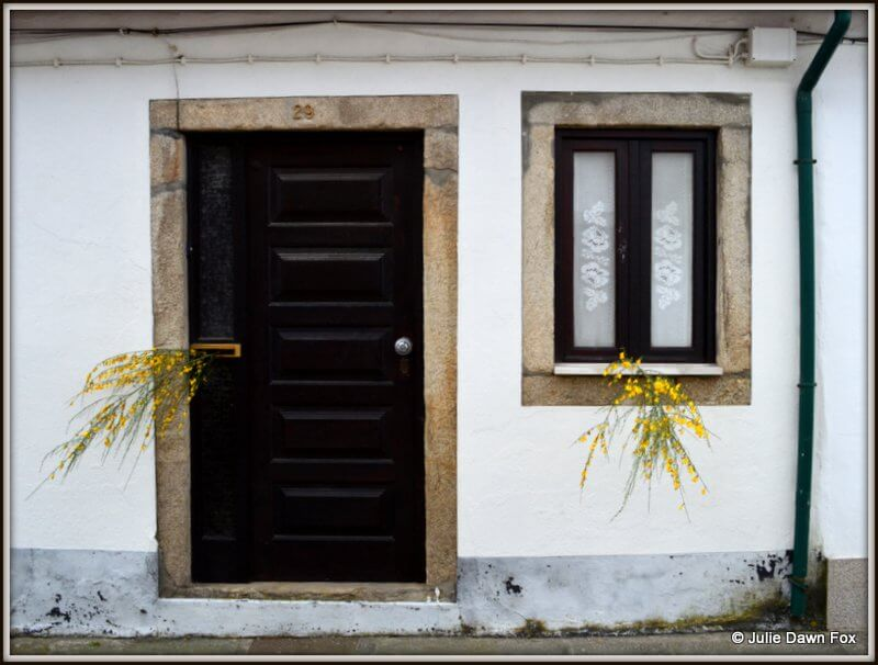 Sprigs of broom in doors and windows, Caminha, Portugal