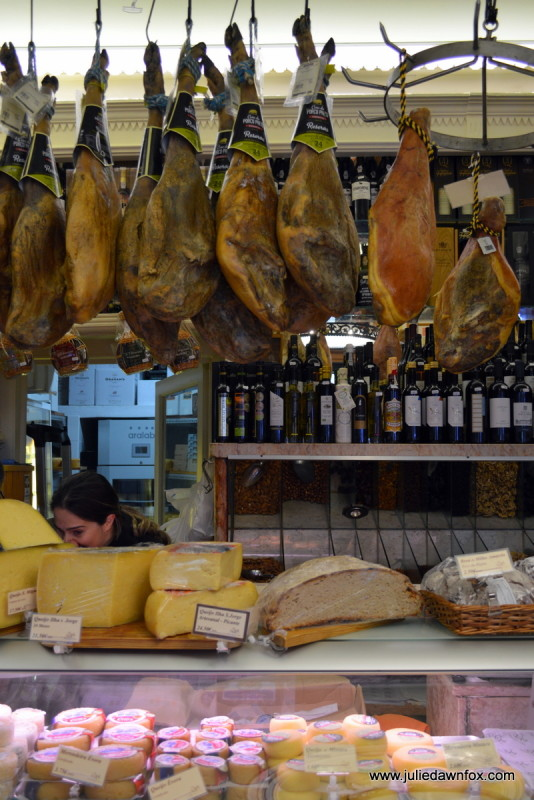 Legs of cured ham and a selection of Portuguese cheeses