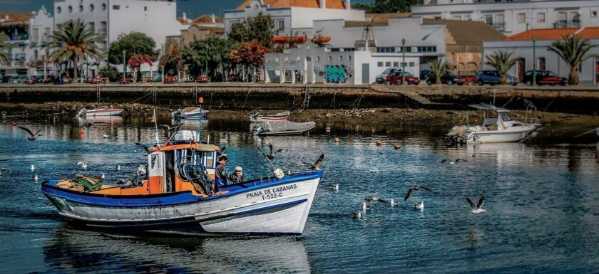 Fishing boat on the Gilão River in Tavira. Things to do in the Algarve