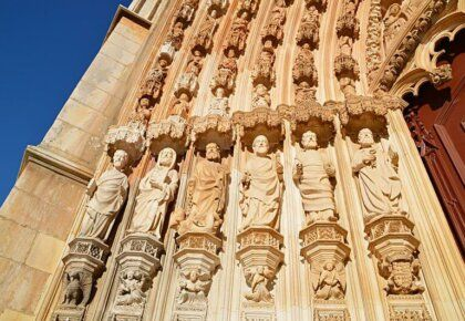 Carved stone figures decorating the doorway to Batalha Monastery