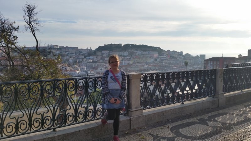 Young girl at São Pedro de Alcântara Miradouro in Lisbon
