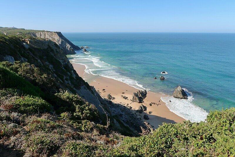 Praia da Adraga with Cabo da Roca in the distance on the GR11 hiking trail
