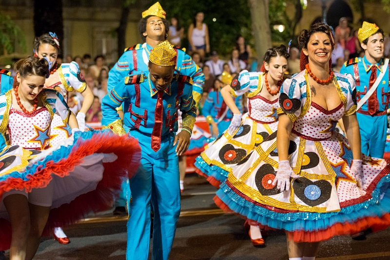 Lisbon, Portugal - June 12, 2014: People wearing costumes at the parade of popular marches (Marchas Populares) during the Saint Anthony Feast at the Liberdade Avenue (Avenida da Liberdade) in Lisbon, Portugal