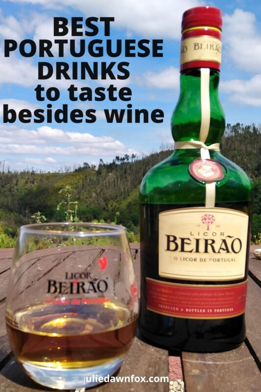 Bottle of Licor Beirao and glass on table.