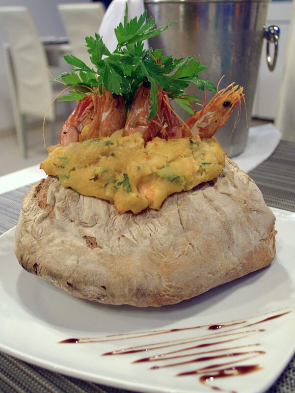 Prawn and bread stew on a plate