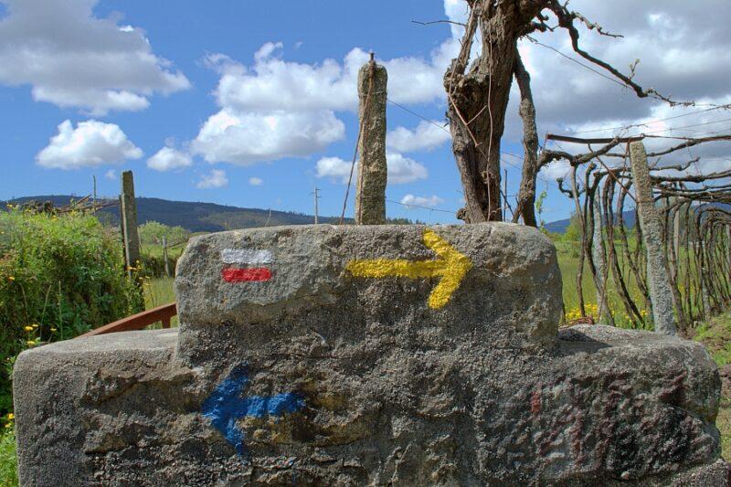 Trail markers for the Grande Rota, Camino de Santiago and Camino de Fatima