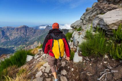 Man hiking. Pico Ruivo and Pico do Areeiro mountain peaks in Madeira, Portugal