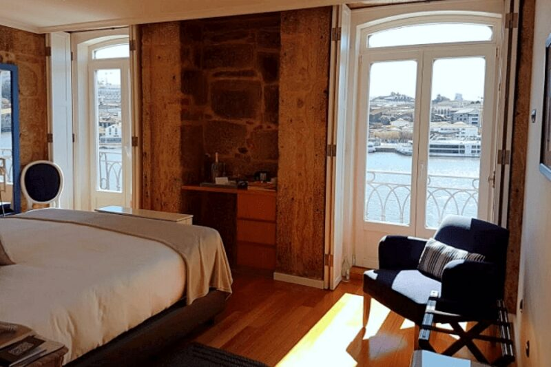 Bedroom overlooking the Douro River at 1872 River House boutique hotel in Porto