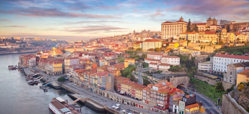 Porto city at sunrise. Lots of historical buildings and holiday apartments for rent