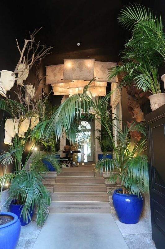 Palms, sculptures and flags in the entrance to Torel 1884 Suites and Apartments, Porto, Portugal