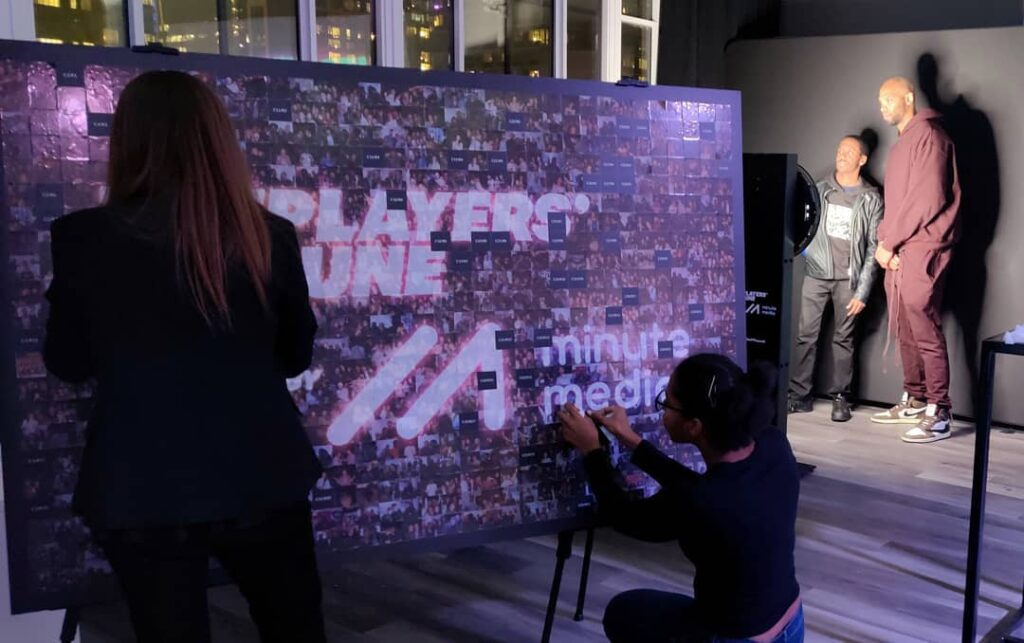 Guests completing the photo mosaic wall in London