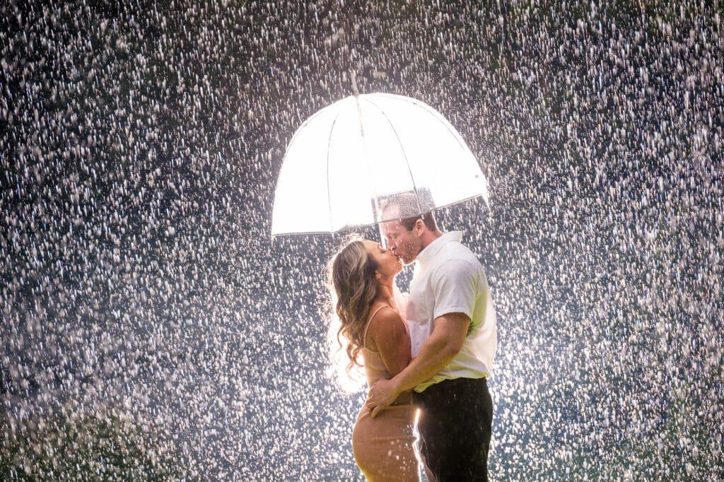 Raining Engagement Photo with Umbrella