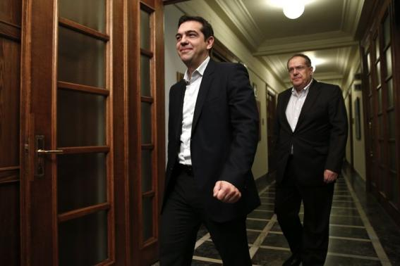 Greek PM Tsipras arrives for the first meeting of the new cabinet in the parliament building in Athens