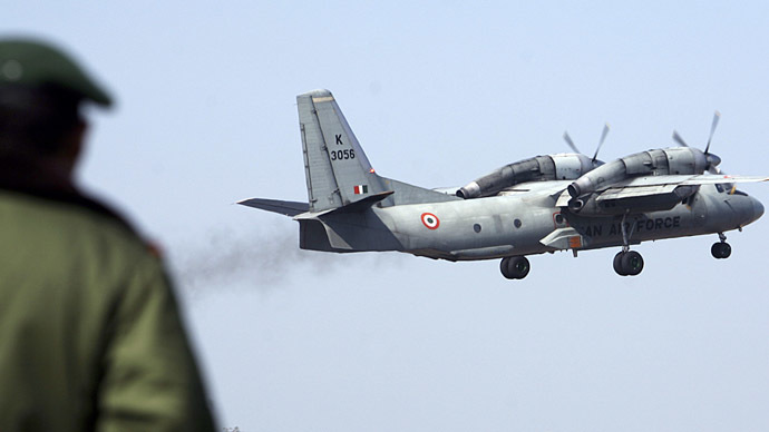 A soldier stands guard as an Indian Air Force AN-32 transport aircraft carrying security personnel takes-off from the technical airport in Jammu. (Reuters / Amit Gupta)