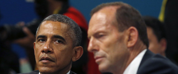 U.S. President Barack Obama listens as Australian Prime Minister Tony Abbott makes opening remarks at the first plenary session of the G20 Summit in Brisbane, Australia Saturday, Nov. 15, 2014. As G-20 summit host Brisbane sweltered through a blistering heat wave, world leaders on Saturday got down to the business of cementing plans to drag a sagging global economy out of the doldrums. (AP Photo/Kevin Lamarque, Pool) | ASSOCIATED PRESS