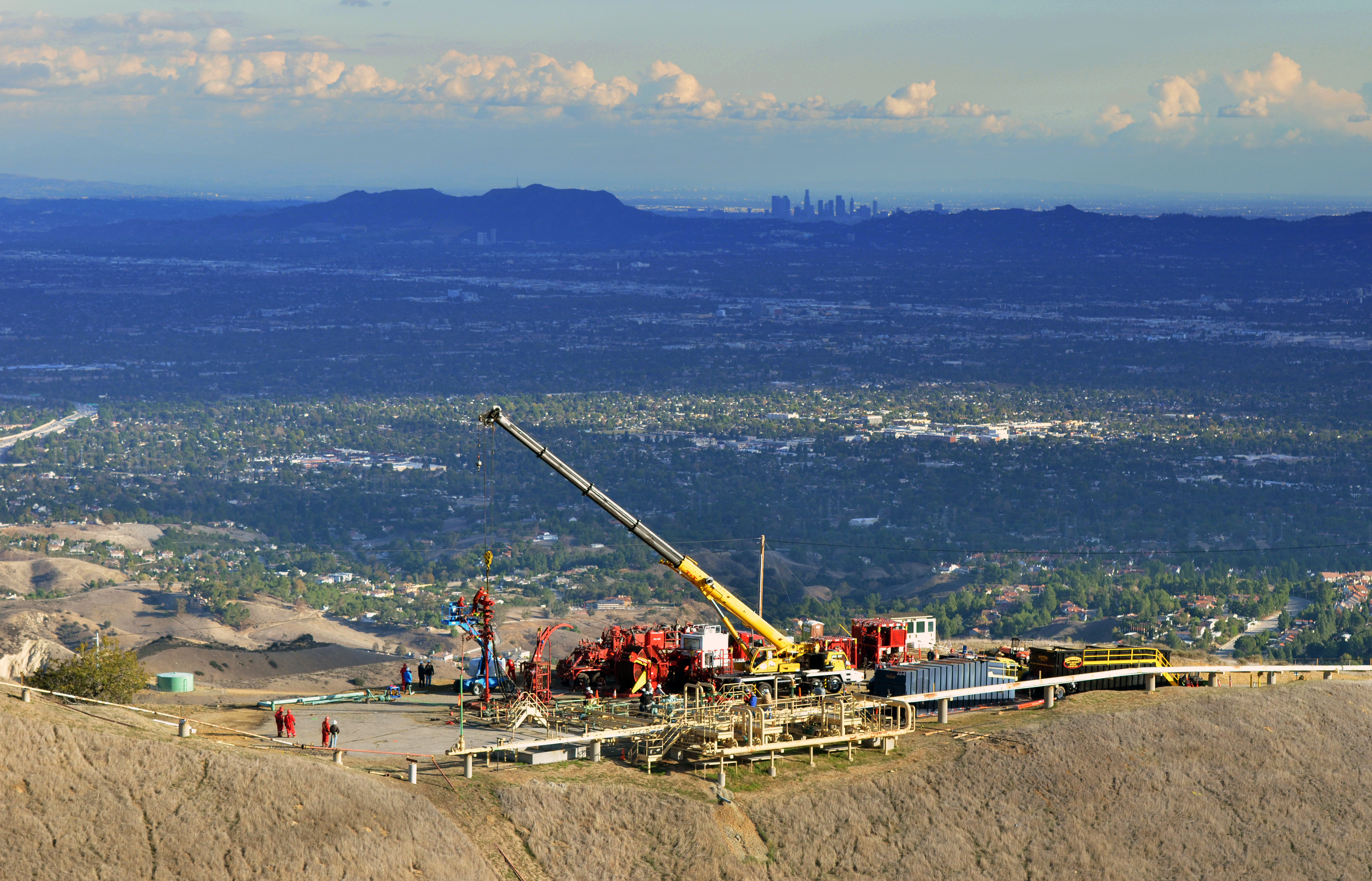 FILE - In this Nov. 3, 2015, file photo, provided by Southern California Gas Co. shows equipment being used as SoCalGas crews and technical experts try to stop the flow of natural gas leaking from a storage well at the utility's Aliso Canyon facility near the Northridge section of Los Angeles. Residents who say the uncontrolled leak from a massive natural gas storage field is making them sick plan to speak at a Los Angeles County Board of Supervisors meeting Tuesday, Nov. 24, 2015, and demand a full investigation of the leak, its causes and possible solutions. (Javier Mendoza/SoCalGas via AP, File)