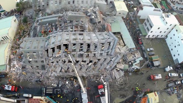 A site where buildings collapsed is seen in this aerial picture taken after a powerful earthquake hit Tainan, southern Taiwan, February 6, 2016. REUTERS/Xinhua
