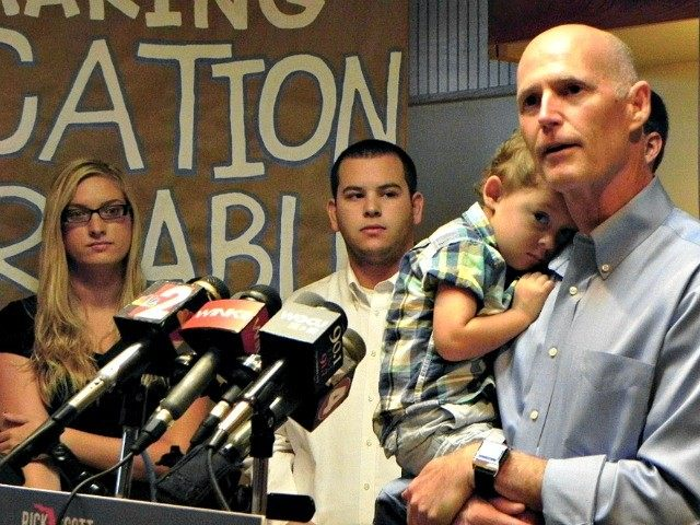 AP/Dave Breitenstein -- Rick Scott addresses media and supporters on Monday at Beef O'Brady's in Estero, Florida.