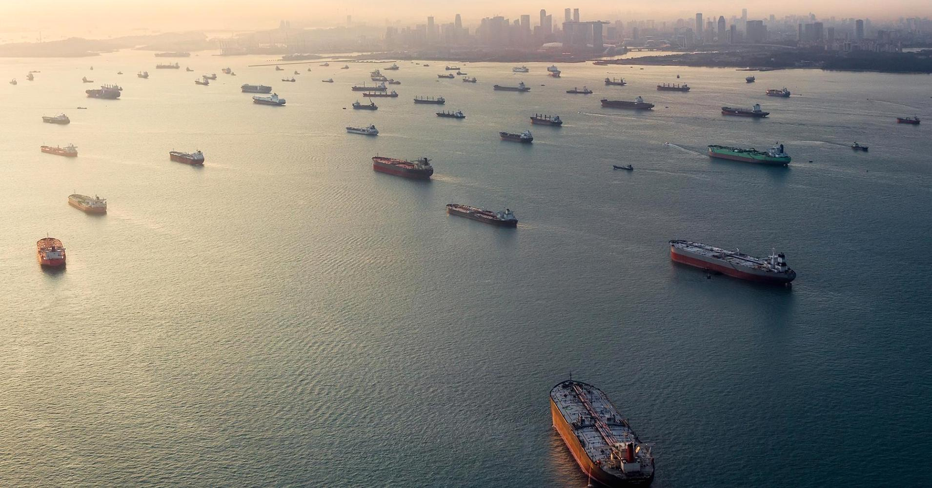 Andrew Rowat | The Image Bank | Getty Images Cargo ships sit idle in the Singapore