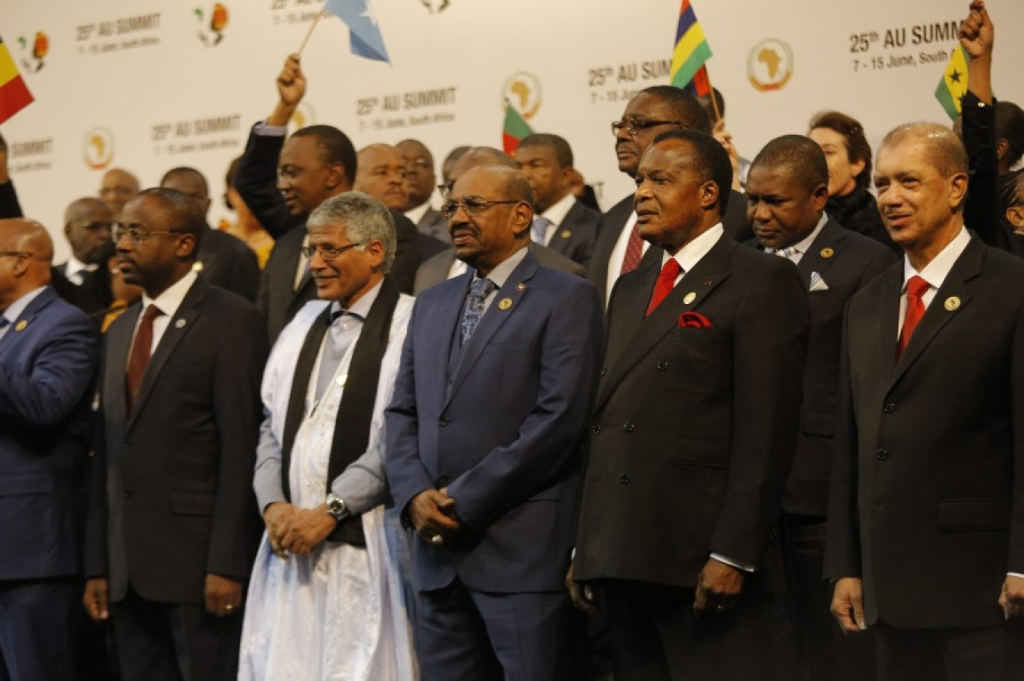 """Sudanese President Omar al-Bashir, center, seen during the """"family photograph"""" taken at the A.U. Summit in Sandton, Johannesburg, South Africa, on June 14. (Kim Ludbrook/EPA)"""