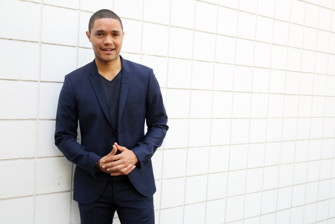 """FILE - In this July 29, 2015, file photo, Trevor Noah, host of the new """"The Daily Show with Trevor Noah,"""" poses for a portrait in Beverly Hills, Calif. The show will premiere on Monday, Sept. 28, on Comedy Central. (Photo by Matt Sayles/Invision/AP, File)"""