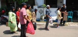 Queue of citizens in Indonesia who can trade their garbage for medicine and medical services