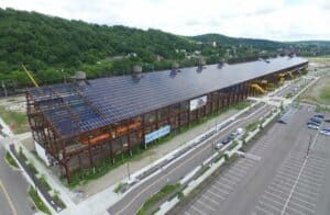 Last of 4,784 silicon solar panels being installed on roof of Mill 19 at Pittsburgh's Hazelwood Green
